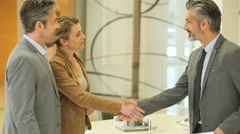 Mature couple giving handshake to architect Stock Footage