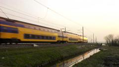 Intercity train passing in a sunset Stock Footage