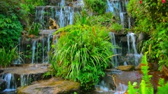 Beautifully Landscaped Artificial Waterfall in Chiang Mai, Thailand Stock Footage