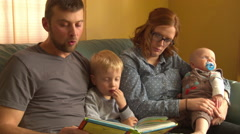 Young Family Reading a Story Stock Footage