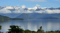 New Zealand Lake Manapouri still water and high snow capped peaks Stock Footage