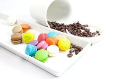 Coffee bean and mini macaroon - stock photo