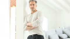 Mature handsome man standing inside home Stock Footage
