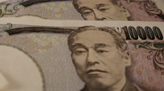 Japanese Yen turning - close up Stock Footage