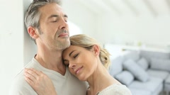 Mature couple embracing each other at home Stock Footage