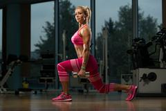 Mature Woman Doing Exercise Dumbbell Squat - stock photo