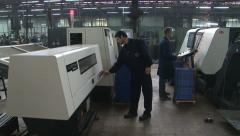 Workers control cnc machine, typing on monitor, set the function. metal industry Stock Footage