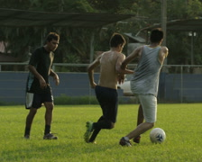 Panning slow motion wide shot of soccer teams playing on field / Esterillos, Stock Footage