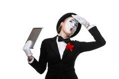 business woman in the image mime holding tablet PC - stock photo