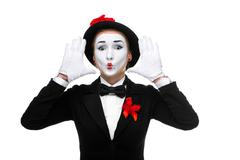 Portrait of the surprised mime with their hands up - stock photo