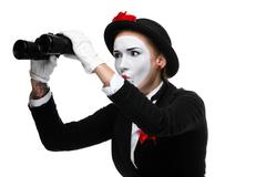 Portrait of the searching mime with binoculars Stock Photos