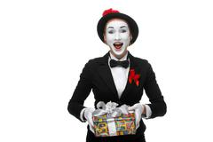 Mime as playful, joyful and excited woman with gift - stock photo