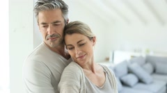 Mature couple embracing each other at home - stock footage