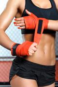 Female boxer does bandage - stock photo