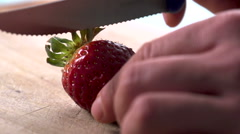 Strawberry slicing slow motion Stock Footage