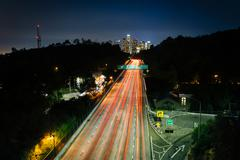 View of the 110 Freeway and downtown Los Angeles Skyline at night, from the P - stock photo