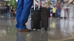 Time lapse of man with luggage in Kunming international airport terminal - stock footage