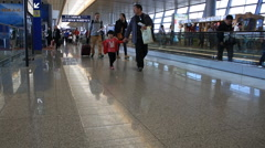 Passengers with luggage walking at Tsingtao international airport - stock footage