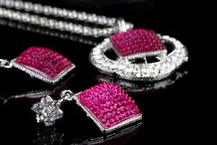 Pink Colored Jewelry Set with Earrings in focus Stock Photos