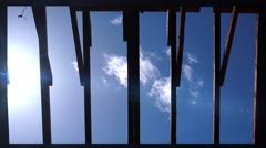 Sunlight through roof beams of building Stock Footage