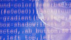Human eyes looking at the source program code. Stock Footage