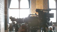 News journalists and cameramen at press conference Stock Footage