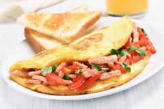 Omelette with vegetables and ham Stock Photos