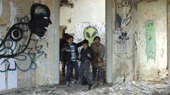 Kids in the abandone graffitti  house Stock Footage