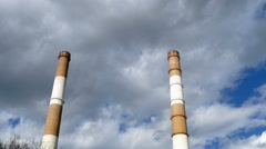Two long pipe heating plant on the background of clouds Stock Footage