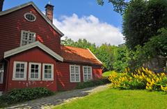 typical red wooden scandinavian house, norway - stock photo