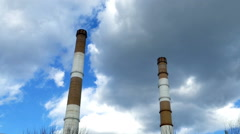 Two long pipe heating plant on the background of clouds - stock footage