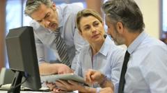Business people working in office on desktop computer - stock footage