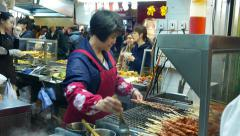 Real and amazing street food scenic: fresh stick kebab stand Stock Footage