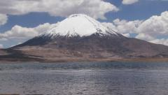 View to the Chungara lake and Parinacota volcano in Lauca National Park, Chile. Stock Footage