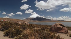 View to the Chungara lake and Parinacota volcano in Lauca Natioanl Park, Chile. Stock Footage