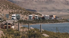 Trucks wait in line for Bolivia-Chile border crossing in Putre Chile. Stock Footage