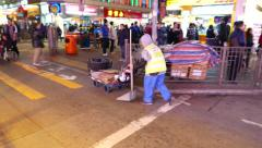 Granny-cleaner on the busy street of HongKong Stock Footage