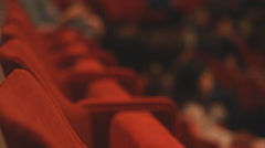 Red seats Blur Audience in the cinema Theatre Stock Footage