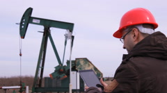 Boss in Industrial machine pump oil jack working in agriculture field Stock Footage