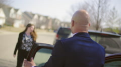Business man and woman reassure each other after car accident HD Stock Footage