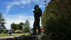 New Zealand Lake Te Anau profile statue of McKinnon and visitors Stock Footage