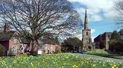 English old church steeple daffodils wind breeze blowing clouds Stock Footage