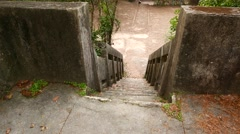 Walking down by mossy concrete staircase, old and forsaken Stock Footage