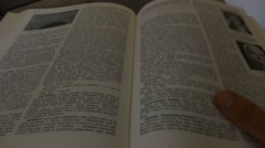 Turning Over The Page In The Book - Encyclopedia - Old Books - stock footage