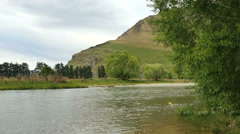 New Zealand Mataura River and grassy cliff Stock Footage