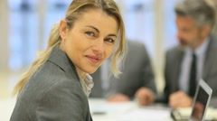 Smiling businesswoman attending work meeting - stock footage
