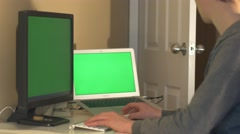 Man browses dual computer monitors then gets up and leaves -green screen Stock Footage