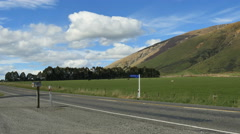New Zealand road with mailbox near pasture and hill Stock Footage