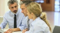 Business team meeting for financial project - stock footage