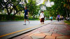 People jogging early morning in Lumpini Park, Bangkok, time-lapse - stock footage